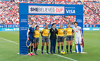 FRISCO, TX - MARCH 11: Megan Rapinoe #15 of the United States poses with the referees and Saki Kumagai #4 of Japan during a game between Japan and USWNT at Toyota Stadium on March 11, 2020 in Frisco, Texas.