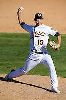 Phoenix Desert Dogs pitcher James Simmons #15, of the Oakland Athletics organization, during an Arizona Fall League game against the Surprise Saguaros at Phoenix Municipal Stadium on October 18, 2012 in Phoenix, Arizona.  The game was called after eleven innings with a 2-2 tie.  (Mike Janes/Four Seam Images)