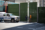 People stand in front of a gate to the Office of Chief Medical Examiner's temporary morgue in New York, the United States, Monday, April 6, 2020.  More than 10,000 people have died from COVID-19 in the U.S..  (Xinhua/Michael Nagle)