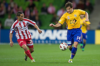 MELBOURNE, AUSTRALIA - OCTOBER 23: Joel Porter of the Gold Coast runs with the ball during the A-League match between the Melbourne Heart and Gold Coast United at AAMI Park on October 23, 2010 in Melbourne, Australia. (Photo by Sydney Low / Asterisk Images)