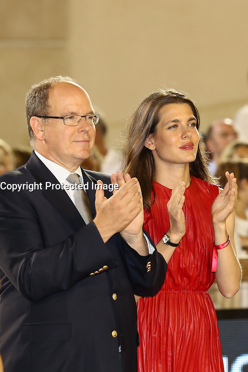 --- NO TABLOIDS NO SITE --- H.S.H. Prince Albert II of Monaco and his niece Charlotte Casiraghi give the prizes to Emanuele Gaudiano, winner of the ÔGrand Prix du PrinceÕ at the Longines Global Champions Tour of Monaco and to Piergiorgio Bucci (2nd) and Rolf-Göran Bengtsson (3rd).
