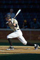 Patrick Frick (5) of the Wake Forest Demon Deacons follows through on his swing against the Liberty Flames at David F. Couch Ballpark on April 25, 2018 in  Winston-Salem, North Carolina.  The Demon Deacons defeated the Flames 8-7.  (Brian Westerholt/Four Seam Images)