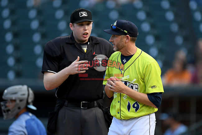 Pitching coach Josh Towers (19) of the Columbia Fireflies makes a point with home plate umpire Mitchell Leikam in a game against the Hickory Crawdads on Tuesday, August 27, 2019, at Segra Park in Columbia, South Carolina. Columbia won, 3-2. (Tom Priddy/Four Seam Images)