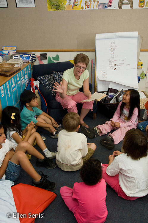 MR / College Park, Maryland.Center for Young Children, laboratory school within the College of Education at the University of Maryland. Full day developmental program of early childhood education for children of faculty, staff, and students at the university..Teacher reads with expression to students during story time. .MR: Kai2.© Ellen B. Senisi