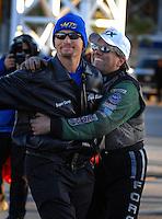 Jan 21, 2007; Las Vegas, NV, USA; NHRA Funny Car driver John Force hugs Top Fuel Dragster driver Jack Beckman during preseason testing at The Strip at Las Vegas Motor Speedway in Las Vegas, NV. Mandatory Credit: Mark J. Rebilas