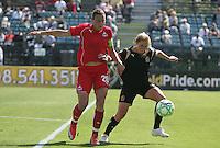 Abby Wambach (20) and Rachel Buehler. Washington Freedom defeated FC Gold Pride 4-3 at Buck Shaw Stadium in Santa Clara, California on April 26, 2009.