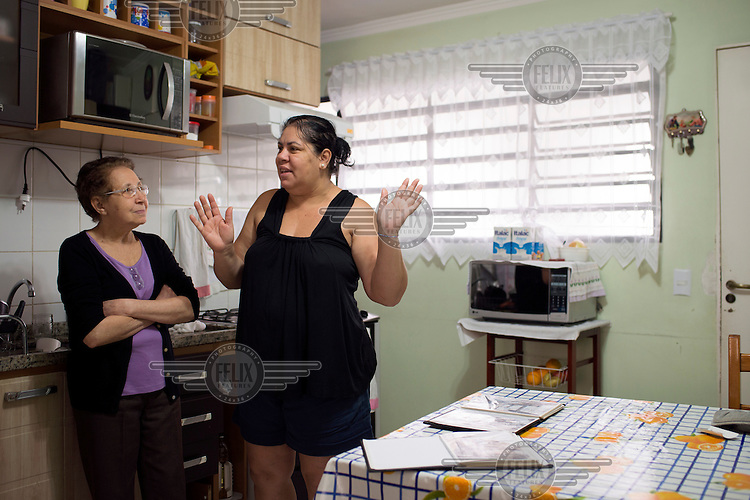 Women of the Da Silva family in their apartment in the Jardim Edith complex. They moved here after a long fight against eviction from the favela where they lived and also a struggle to access decent housing.