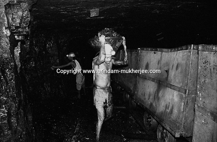 Workers working inside an inclined mine at North Searsole Coliery in Ranigunj, West Bengal, India. Arindam Mukherjee