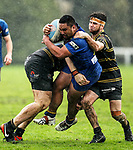 Anthony Fuimaono of Howick is tackled. Fox Memorial Rugby League, Northcote Tigers v Howick Hornets, Birkenhead War Memorial Park Auckland, Saturday 22nd July 2017. Photo: Simon Watts / www.bwmedia.co.nz