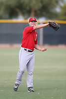 Jared Walsh (4) of the AZL Angels warms up before a game against the AZL Rangers at the Texas Rangers Spring Training Complex on July 1, 2015 in Surprise, Arizona. Rangers defeated the Angels, 3-1. (Larry Goren/Four Seam Images)
