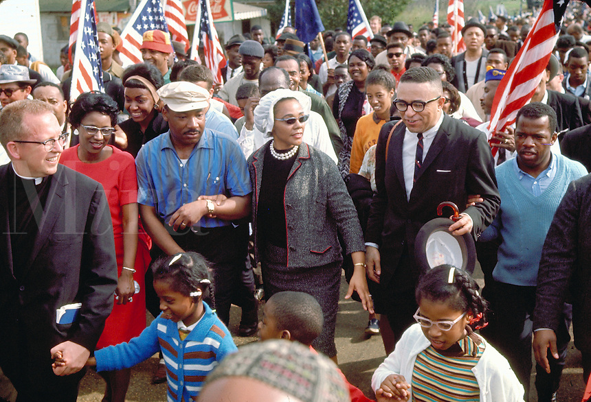 Selma to Montgomery March for voting rights. King family lead marchers into Montgomery. Martin Luther King and Coretta Scott King, left - John Lewis (blue sweater); in front, L to R, King children