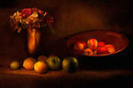 Traditional still life of apples, lemons, and flowers with a painterly quality