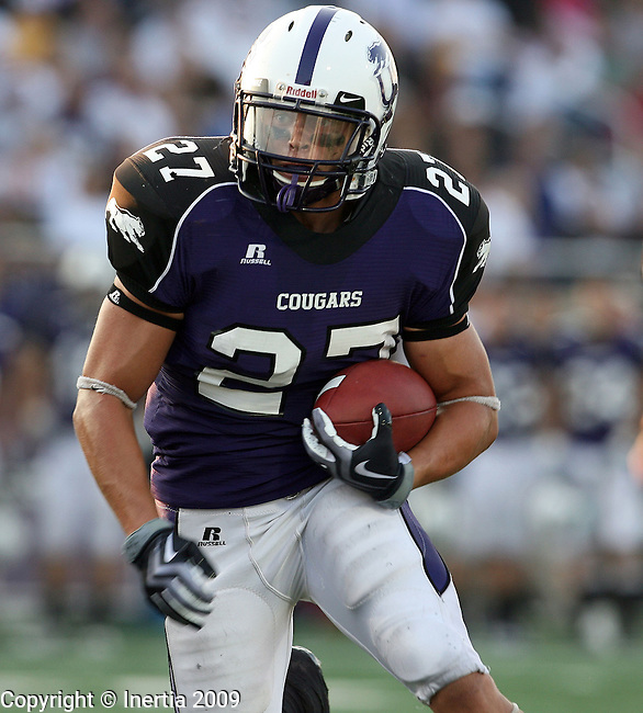 SIOUX FALLS, SD - SEPTEMBER 5:  Ryan Lowmiller #27 of the University of Sioux Falls picks up yardage against Nebraska Wesleyan during the second quarter of their game Saturday evening at the USF Sports Complex. (Photo by Dave Eggen/Inertia).