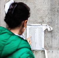 05.06.2013, Potocari ( Srebrenica ) Bosnia Herzegovina<br /> Una visitatrice guarda la lista delle vittime identificate di recente. <br /> L'esercito Serbo nel 1995 ha massacrato a Srebrenica circa 8.000 tra uomini e ragazzi Musulmani, la piu' grande atrocita' commessa in Europa dalla seconda guerra mondiale. <br /> Foto Insidefoto / EXPA/ Juergen Feichter
