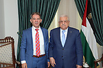 Palestinian President Mahmoud Abbas meets with ahead of the anti-corruption commission, Raed Radwan in the West Bank city of Ramallah on July 18, 2021. Photo by Thaer Ganaim