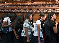 Antigua, Guatemala.  Semana Santa (Holy Week).  Women carrying an anda (float) in a procession during Holy Week.