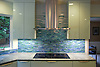 This custom kitchen backsplash features Mist, a handmade mosaic shown in blue, white and green 1.5cm jewel glass stalks from New Ravenna.<br />