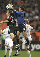 30 October,  2004.   DC United Nick Rimando (18) pulls in a save while playing the MetroStars during the 2004 MLS playoffs at RFK Stadium in Washington, DC.