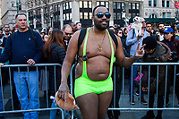 NEW YORK - NEW YORK. JANUARY 12: A participant of the No Pants Subway Ride gets ready to take a ride on the NYC subway system on January 12, 2020 in New York. The annual event, in which participants board a subway car in January while not wearing any pants while behaving as though they do not know each other, began as a joke by the public prank group Improv Everywhere in New York City and has since spread around the world, with enthusiasts in around 60 cities and 29 countries across the globe, according to the organization's site.  (Photo by Pablo Molsalve/VIEWpress)
