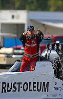Aug 31, 2014; Clermont, IN, USA; NHRA top fuel dragster driver T.J. Zizzo reacts on the return road during qualifying for the US Nationals at Lucas Oil Raceway. Mandatory Credit: Mark J. Rebilas-USA TODAY Sports