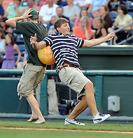 August 13, 2009: Two people playing a between-innings game are about to take a tumble at Fluor Field at the West End in Greenville, S.C. Photo by: Tom Priddy/Four Seam Images
