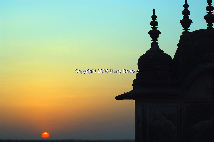 Sunset with minarets in the foreground in Jaipur India.