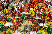 Rio de Janeiro, Brazil. Carnival samba school parade; float with fruit coctail theme; girls in scanty gold bikinis.
