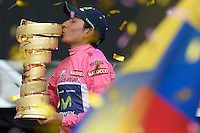 TRIESTE - ITALIA. 01-06-2014. Nairo Alexander  Quintana Rojas -Col- (Movistar) besa el trofeo de campeón general de la versión 97 del Giro de Italia hoy 22 de mayo de 2014. / Nairo Alexander  Quintana Rojas -Col- (Movistar)kisses the trophy of champion of the 97th version of Giro d'Italia today May 22th 2014 Photo: VizzorImage/ Fabio Ferrari / LaPresse<br /> VizzorImage PROVIDES THE ACCESS TO THIS PHOTOGRAPH ONLY AS A PRESS AND EDITORIAL SERVICE AND NOT IS THE OWNER OF COPYRIGHT; ANOTHER USE HAVE ADDITIONAL PERMITS AND IS  REPONSABILITY OF THE END USER