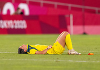 KASHIMA, JAPAN - AUGUST 5: Sam Kerr #2 of Australia sits on the field after a game between Australia and USWNT at Kashima Soccer Stadium on August 5, 2021 in Kashima, Japan.