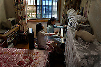 Bella and her family.  This is the family that Leslie Chang is basing her entire story on the middle class of China. Bella Zhou and her parents.  She is having piano lesson with her teacher Key (piano@citiz.net) and then shopping with her family...Address is:.Liangcheng Lu 357 Nong Building One Apt. 702 (this is near intersection of Guangling Silu).Father's mobile number is:  +86 136 8198 1528 his name is Zhou Ji Lang.Bella mobile is: +86 137 0166 2855 and her email is: 1224madamadadane@sina.com