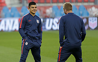 TORONTO, ON - OCTOBER 15: Nick Lima #16 of the United States chats with a teammate prior to the start of the game during a game between Canada and USMNT at BMO Field on October 15, 2019 in Toronto, Canada.