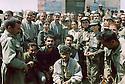 Iraq 2003.The day of the liberation of Mandili, in the center with a cap, Mala Baktiar, with men and women peshmergas.Irak 2003.Le jour de la liberation de Mandili, Mala Baktiar au centre avec une casquette pose avec les peshmergas femmes et hommes.