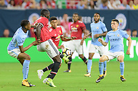 Houston, TX - Thursday July 20, 2017: Tosin Adarabioyo, Romelu Lukaku and Phil Foden during a match between Manchester United and Manchester City in the 2017 International Champions Cup at NRG Stadium.