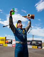 Jul 21, 2019; Morrison, CO, USA; NHRA funny car driver Tommy Johnson Jr celebrates after winning the Mile High Nationals at Bandimere Speedway. Mandatory Credit: Mark J. Rebilas-USA TODAY Sports