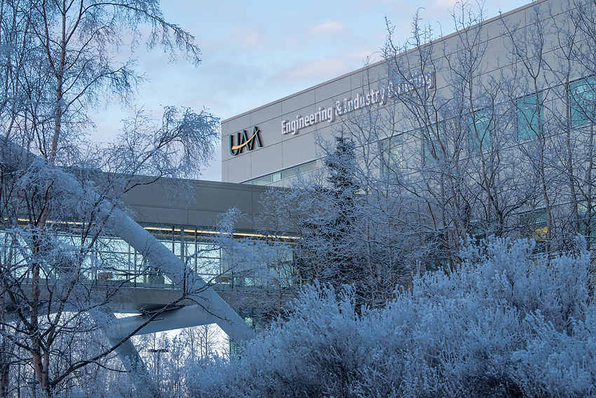 Frost-covered trees frame UAA's Engineering and Industry Building.