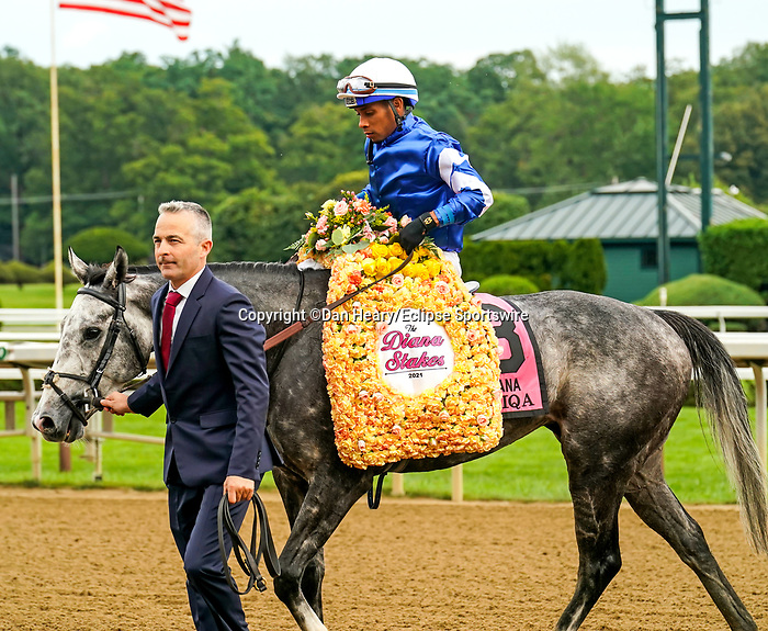 July 17, 2021: Connections of Althiqa #8, celebrate after winning the Diana Stakes (Grade 1) for fillies and mares four years and upward at Saratoga Race Course in Saratoga Springs, New York on July 17, 2021. Dan Heary/Eclipse Sportswire/CSM