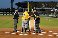 Siena Saints head coach Tony Rossi (40) shakes hands with umpire Olinda Mattia during introductions before the season opening game against the Central Florida Knights at Jay Bergman Field on February 14, 2014 in Orlando, Florida.  UCF defeated Siena 8-1.  (Mike Janes/Four Seam Images)