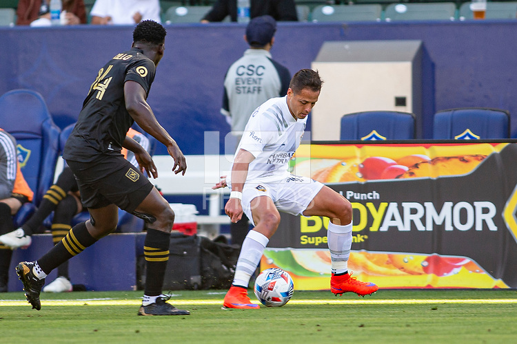 CARSON, CA - MAY 8: Javier Hernandez #14 of the Los Angeles Galaxy moves with the ball during a game between Los Angeles FC and Los Angeles Galaxy at Dignity Health Sports Park on May 8, 2021 in Carson, California.