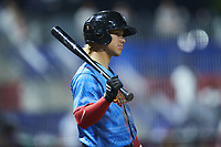 Kenedy Corona (10) of the Guerreros de Fayetteville waits for his turn to hit during the game against the Rapidos de Kannapolis at Atrium Health Ballpark on June 24, 2021 in Kannapolis, North Carolina. (Brian Westerholt/Four Seam Images)