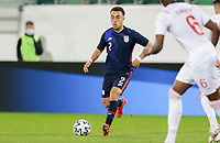 ST. GALLEN, SWITZERLAND - MAY 30: Sergino Dest #2 of the United States looks for an open man downfield during a game between Switzerland and USMNT at Kybunpark on May 30, 2021 in St. Gallen, Switzerland.