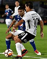 BOGOTA - COLOMBIA – 28 - 02 - 2018: John Duque (Izq.) jugador de Millonarios (COL), disputan el balon con Jadson (Der.) jugador de Corinthians (BRA), durante partido entre Millonarios (COL) y Corinthians (BRA), de la fase de grupos, grupo 7, fecha 1 de la Copa Conmebol Libertadores 2018, en el estadio Nemesio Camacho El Campin, de la ciudad de Bogota. / John Duque (L) player of Millonarios (COL), fights for the ball with Jadson (R) player of Corinthians (BRA), during a match between Millonarios (COL) and Corinthians (BRA), of the group stage, group 7, 1st date for the Conmebol Copa Libertadores 2018 in the Nemesio Camacho El Campin stadium in Bogota city. VizzorImage / Luis Ramirez / Staff.