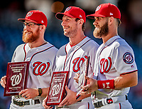 26 September 2018: Washington Nationals players (left to right) Sean Doolittle, Max Scherzer, and Bryce Harper receive Awards prior to a game against the Miami Marlins at Nationals Park in Washington, DC. The Nationals defeated the visiting Marlins 9-3, closing out Washington's 2018 home season. Mandatory Credit: Ed Wolfstein Photo *** RAW (NEF) Image File Available ***