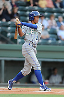 Shortstop Raul Adalberto Mondesi (2) of the Lexington Legends in a game against the Greenville Drive on Friday, August 16, 2013, at Fluor Field at the West End in Greenville, South Carolina. Mondesi is the No. 5 prospect of the Kansas City Royals. Greenville won, 2-1. (Tom Priddy/Four Seam Images)