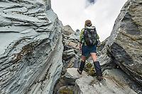 Tramper among huge boulders in Copland Valley, Westland National Park, West Coast, World Heritage Area, South Westland, New Zealand