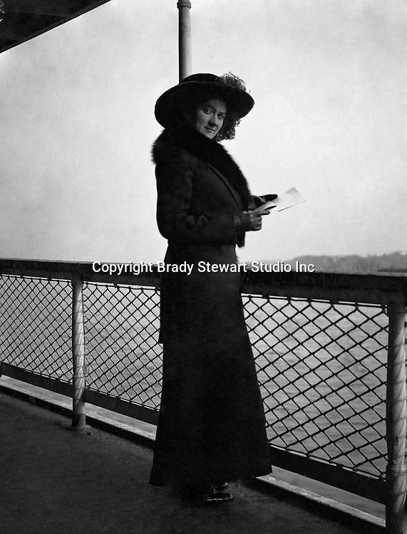 Washington DC:  Sarah Stewart standing next to the ship's railing while taking a cruise on the Potomac River. Brady and Sarah  Stewart site seeing in Washington DC while on their honeymoon.