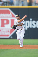 Charlotte Knights shortstop Leury Garcia (24) makes a throw to first base against the Norfolk Tides at BB&T BallPark on July 17, 2015 in Charlotte, North Carolina.  The Knights defeated the Tides 5-4.  (Brian Westerholt/Four Seam Images)
