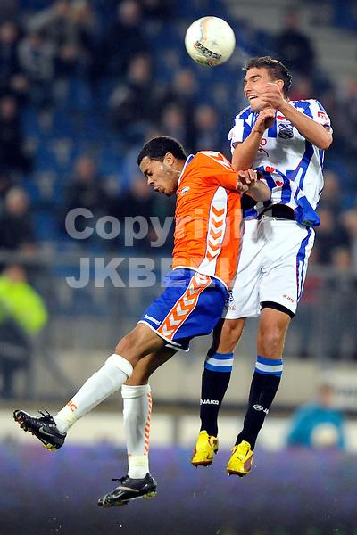 voetbal sc heerenveen - rbc  knvb beker seizoen 2009-2010 28-10-2009 angelo zimmerman verliest kopduel van assaidi