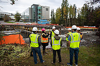 Geomatics students from Assistant Professor David Brock's Engineering Surveying (GEO 256) course join UAA Facilities personnel to tour the work being done by the Municipality of Anchorage to replace the Chester Creek culverts under Providence Drive outside UAA.