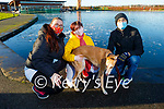 Padraig, Helena and Ava Stackpoole and Alba the dog enjoying a stroll around the frozen lake in the Tralee Bay Wetlands on Sunday.