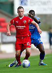 St Johnstone v Morton..24.08.10  CIS Cup Round 2.Carlo Monti and Cleveland Taylor.Picture by Graeme Hart..Copyright Perthshire Picture Agency.Tel: 01738 623350  Mobile: 07990 594431